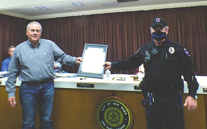 Mayor Ken Jordan is shown presenting an engraved plaque to Police Sergeant Charlie Boyce on behalf of all members of San Saba Police Deparment in honor of National Police Week (May 10th-16th) which is recognized annually. Photo by Djuana Payton