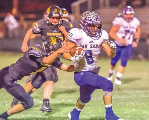 October 12, 2018 – San Saba Armadillos vs Goldthwaite Eagles – 101st meeting; 78-0 victory; #8 Eli Salinas runs through a tackle on a long touchdown run. (Photo by Buddy Whitley)