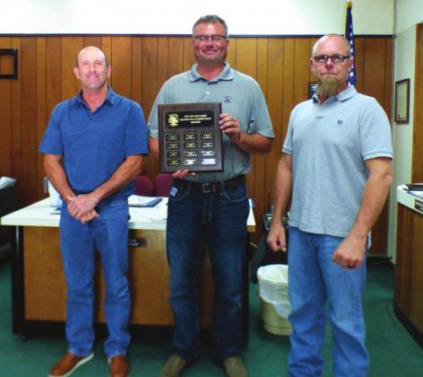 Michael Whitley, Golf Course Supervisor, displays a Supervisor of the Month plaque with his name engraved for selection as the City's Supervisor of the Month for the Third Quarter. He also received a gift certificate to a local restaurant. On Michael's right is Scott Glaze, City Public Works Director, and to his left is Michael Nelson, Alderman.